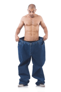 man holding waist of extra large jeans