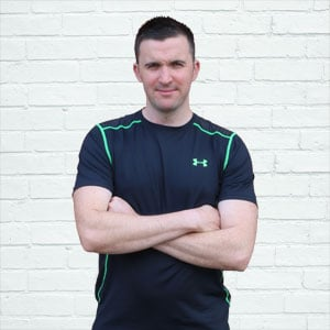 image of david marshall, personal trainer, with arms folded across his chest